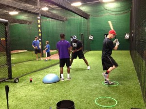 Darrian Graves (Duluth High School) works out with CJ Stewart in the Hitting Lab to prepare for a showcase, while Jason Shirley (Youngstown State University) gets ready for college summer league play.