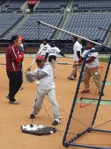 Miles Jackson takes a swing during the L.E.A.D. Celebrity Clinic at Turner Field.